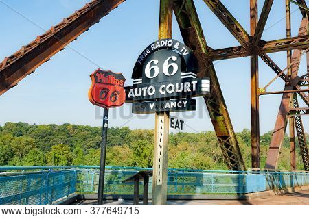 St Louis Usa - September 3 2015; Old Promotional Signs Below Truss Structure On Chain Of Rocks Histo