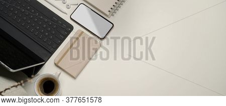 Office Desk With Copy Space, Digital Devices, Stationery And Coffee Cup On White Table