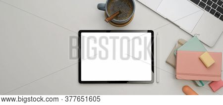Study Table With Mock Up Tablet, Laptop, Notebooks, Stationery And Coffee Cup