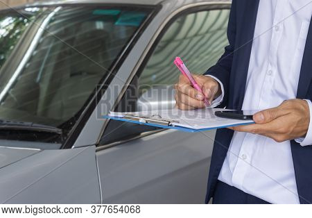 Standing Asian Insurance Agent Or Insurance Agency In Suit Checking Car Crash Data Report From Accid