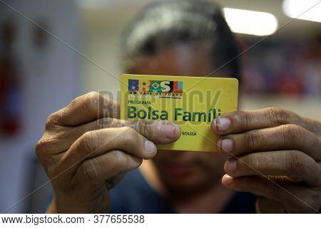 Salvador, Bahia / Brazil - August 11, 2017: Family Allowance Card Is Seen As A User Of The Social Be
