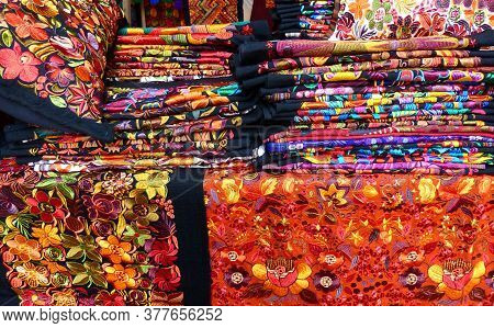 Cuenca, Ecuador - June 24, 2019: Colorful Embroidered Decorative Textile From Otavalo City At The Ar