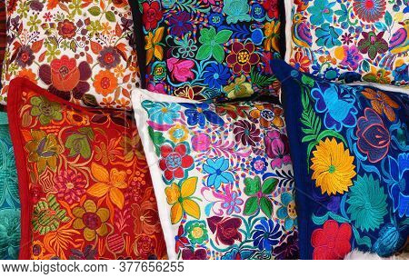 Cuenca, Ecuador - November 2, 2020: Close Up Of сolorful Embroidered Decorative Pillows And Textiles