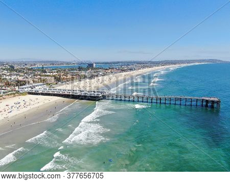 Aerial View Of People At The Beach Near The Pier With During Blue Summer Day. Pacific Beach In San D