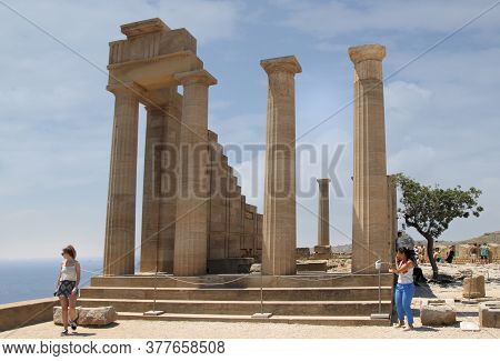 Lindos, Rhodes, Greece - July 10, 2020: Acropolis Of Lindos, The Ruins Of An Ancient Temple And The