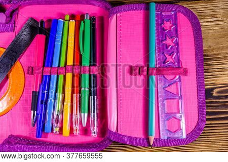 Different School Stationeries (pens, Pencils, Ruler And Protractor) In Pink Pencil Box. Top View