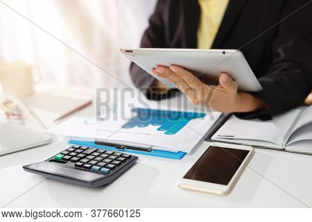 Businesswoman Hands In Black Suit Sitting And Touching Tablet Black Screen. Woman Working Or Using C