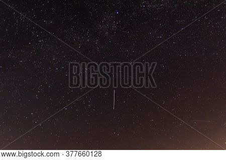 Background Of Night Sky With Many Stars. Satellite Trajectory