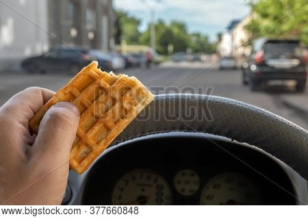 Food, Cookies In The Hand Of A Car Driver While Driving In The City