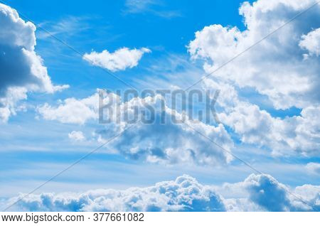 Blue sky background, vast cloudy blue sky landscape panoramic scene. Colorful sky view in bright tones, sunny sky landscape, morning sky nature. Panoramic sky background.