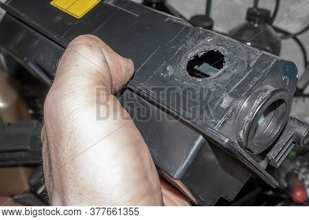 A Hole From Poor Quality Disassembly Of The Cartridge Case From The Printer For Refilling Toner In T
