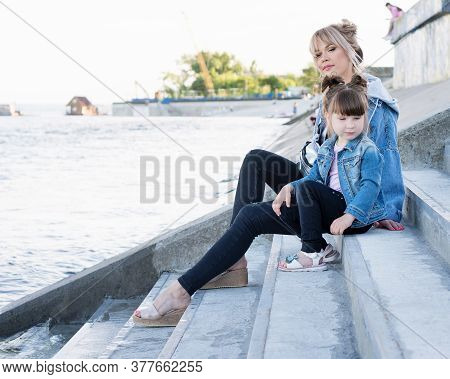 Mother And Child Walking On Sea Promenade Street. Travel And Holiday. Family Time Together. Modern D