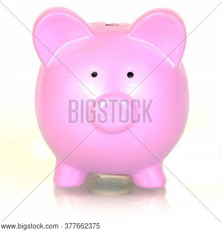 An Isolated Over White Image Of A Pink Piggy Bank.