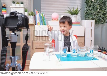 Asian School Boy Making Easy Chemistry Experiments And Recording A Video For His Followers, Young Bl