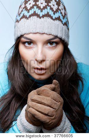 woman warm hands in gloves