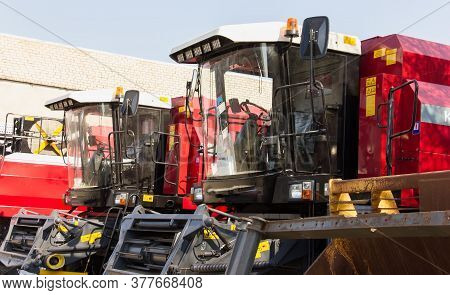 Tractors And Cab Harvesters. Agricultural Machinery At The Assembly Plant