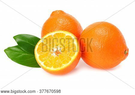 Orange Clementine Or Minneola Tangelo With Slices And Green Leaves Isolated On White Background. Tan
