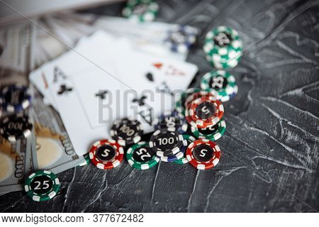 Poker Cards And Stacks Of Poker Chips On A Grey Background. Poker Online Concept