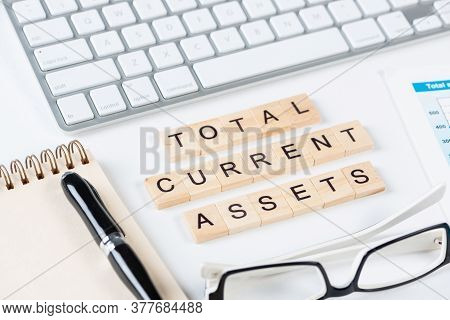 Total Current Assets Concept With Letters On Cubes. Still Life Of Office Workplace With Supplies. Fl