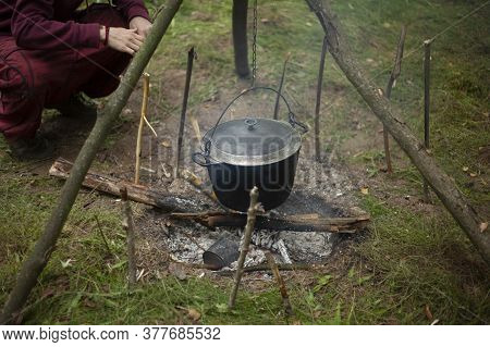 Boiler On The Fire. Cooking Boiler For Camping. Tourist Center. A Container For Boiling Water Over A