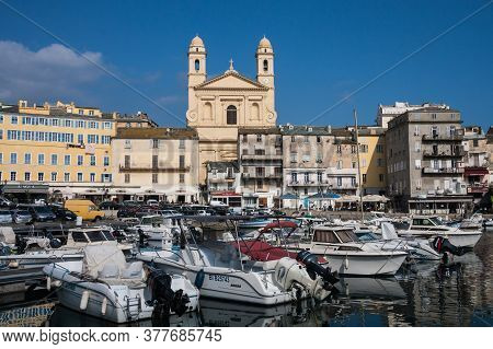 Bastia, Corsica, France March 4 2012: Port Of Bastia View With Boats, Buildings And Church. Bastia I