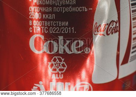 Astrakhan, Russia, 22 Jul. 2020: Coca-cola Drink. Popular Soda Pop Side View Of Aluminium Can With B
