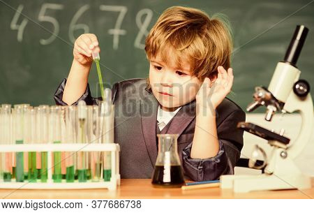 Small Boy With Microscope At School Lesson. Student Do Science Experiment With Microscope In Lab. Mi