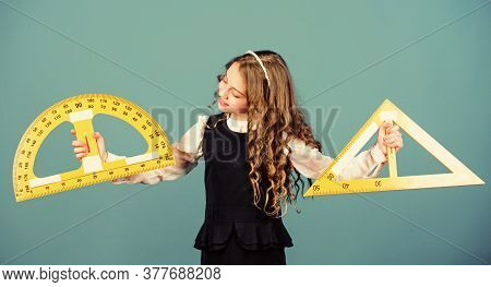 School Student Learning Geometry. Pupil Girl With Big Rulers. Math Lesson. Education And Knowledge.