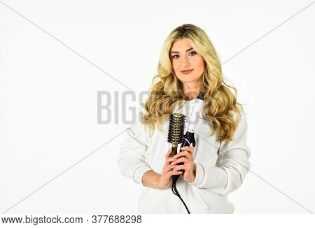 Woman With Long Curly Hair Use Curling Iron. Hairdresser Tips. Girl Adorable Blonde. Buy Tools. Onli
