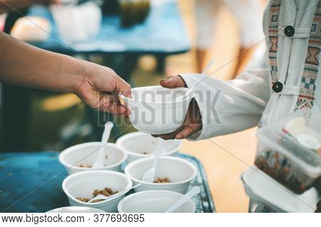 Donate Food To The Poor : Concept Sharing Food With Homeless