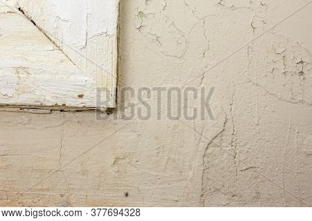 Roughly Painted Old White Wall With Part Of A Shabby Wooden Window Frame. Beautiful Abstract Grunge