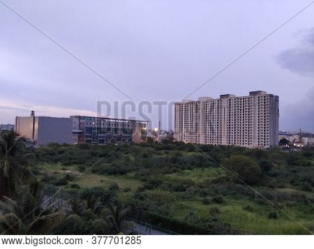 Closeup Of Indian Yellow Color Multi Floored Apartment In A City With Rainy Cloud Background Or Even