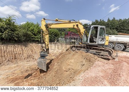 Large Digger Digs A Hole For The Cellar Of A Family House