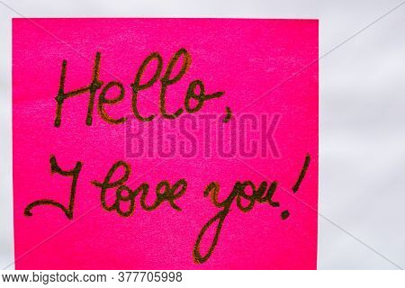 Hello I Love You Handwriting Text Close Up Isolated On Pink Paper With Copy Space. Writing Text On M