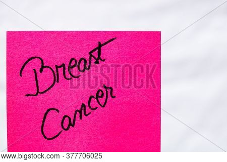 Breast Cancer Handwriting Text Close Up Isolated On Pink Paper With Copy Space. Writing Text On Memo
