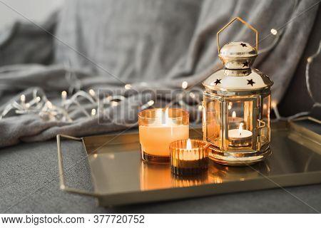 Metal Lantern And Burning Candles On A Golden Metal Tray. Eid Al Adha Celebration. Muslim Holiday At