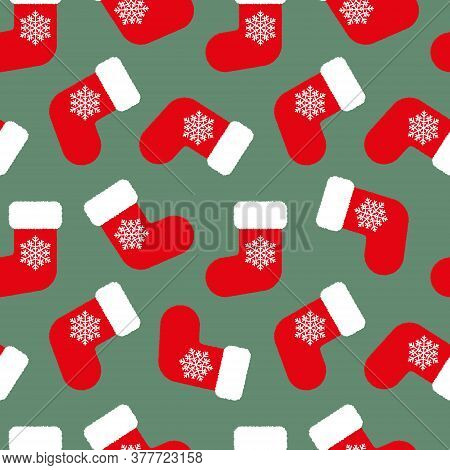 Red Fluffy Christmas Stockings With White Snowflakes On Green Background Seamless Pattern. Vector Ch