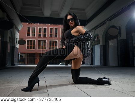 Beautiful Brunette Girl In High Boots On Heels And With Perfect Butt Posing Outdoor On The City Squa