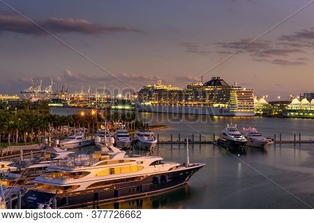 Miami, Florida, Usa - January 8, 2020 : Msc Divina Cruise Ship In The Port Of Miami At Sunset With M