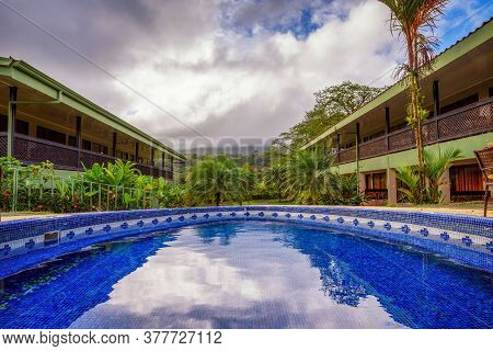 La Fortuna, Costa Rica - January 16, 2020 : Hotel Lavas Tacotal With An Outdoor Pool. It Is Located