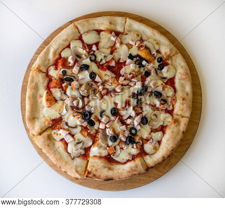 The Pizza With Olives And A Mushrooms