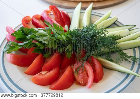 A Plate Of Fresh Vegetables - Tomato And Cucumber