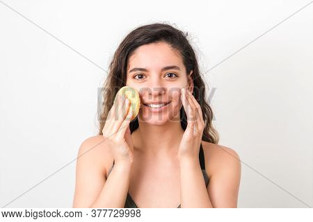 Beauty Portrait Of Attractive Caucasian Woman With Big Beautiful Eyes And Curly Hair Washing Her Fac