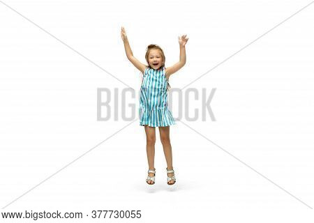 Happy Child, Little And Emotional Caucasian Girl Jumping And Running Isolated On White Background. L