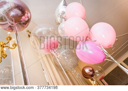 A Bouquet Of Helium Balloons With Feathers And Ribbons. Decoration Of The Banquet Hall In Pink And W
