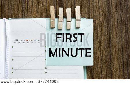 First Minute Notes Paper And A Clothes Pegs On Wooden Background