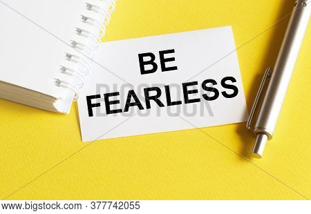 White Paper With Text Be Fearless On A Yellow Background With Stationery