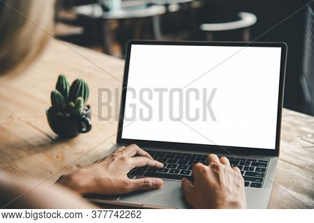 Rear View Mockup Image Of A Woman's Hand Working On A Laptop With Blank White Desktop Copy Space Scr