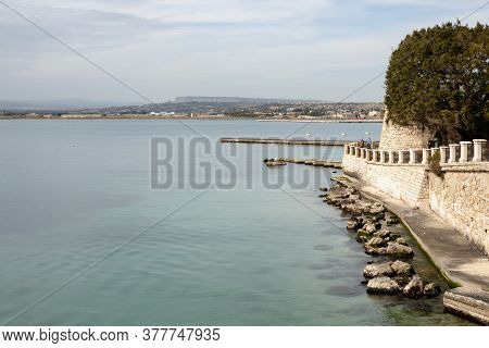 Siracusa, Sicily - February 13, 2020: The Fortification Wall Of The Arethusa Spring (fonte Aretusa)