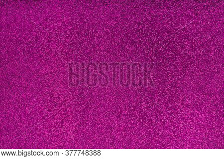 Glittering Purple Surface With Glow Effect. Blurred, Bokeh, Defocused. Party Decoration. Holiday Glo